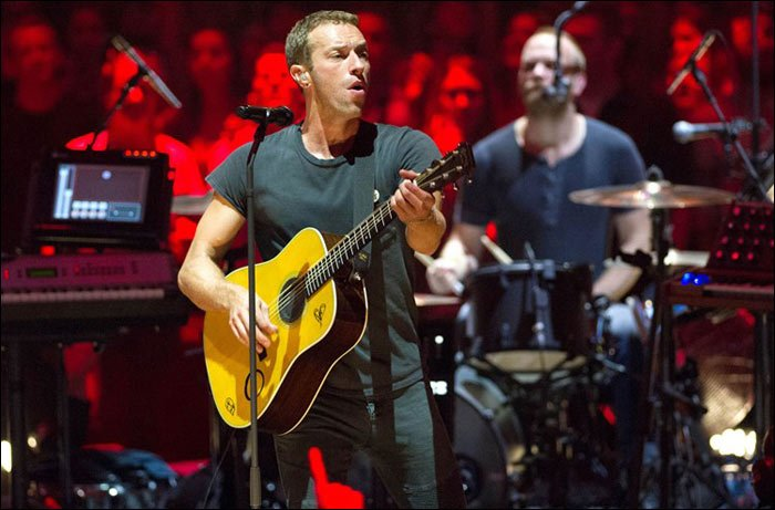 Chris Martin of Coldplay jams with the band live on stage. They put on a great performance everytime.