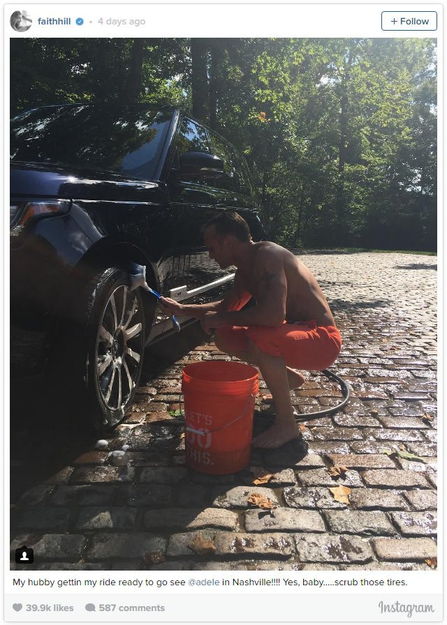 Tim McGraw washes his wife's (Faith Hill) car and he's shirtless!