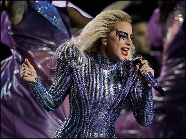 LADY GAGA is seen here performing live at the Super Bowl. She surely is something to witness!