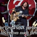 Here is Dave Grohl on the 'throne' that he designed after his foot was broken during a concert in Sweden three years ago.